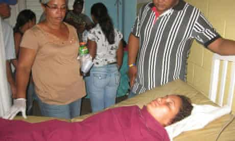 A survivor of the Dominican Republic migrant boat sinking rests in hospital.