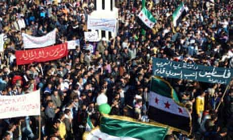 Demonstrators protest against Syria's Bashar al-Assad in the town of Hula near Homs, 3 February 2012