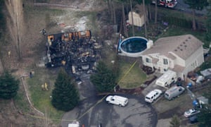 The smoldering remains of a house, left, where an explosion killed Josh Powell and his two sons
