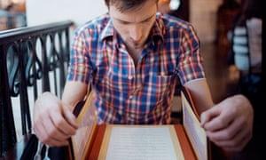 A man reading a menu