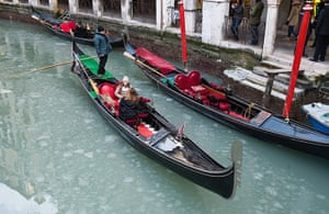 Frozen Venice: Tourists brave the weather on a partially frozen canal