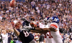 Super Bowl 2012: The New York Giants and the New England Patriots battle for the ball