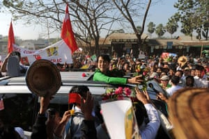 Aung San Suu Kyi campaign: Aung San Suu Kyi is surrounded by a crowd of supporters