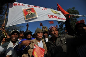 Aung San Suu Kyi campaign: Supporters greet Aung San Suu Kyi on her way to a political rally