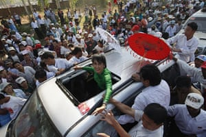 Aung San Suu Kyi campaign: Aung San Suu Kyi greets supporters from  her vehicle after her speech