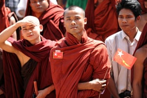 Aung San Suu Kyi campaign: Buddhist monks listen to a speech at a political rally in Pathein