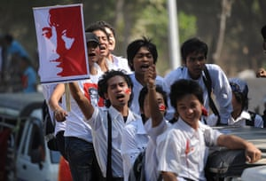 Aung San Suu Kyi campaign: Supporters wave pictures of Aung San Suu Kyi as they travel with her