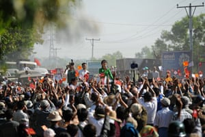 Aung San Suu Kyi campaign: Aung San Suu Kyi talks to supporters on her way to a political rally