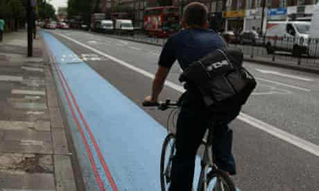 A cyclist on a blue bike lane in west London