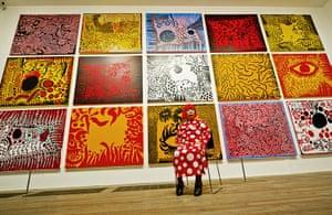 Yayoi Kusama: Artist Yayoi Kusama poses for a photograph with her artwork