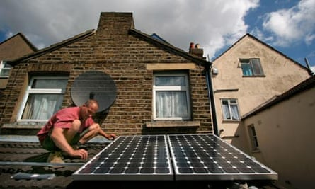 Solar panels being installed on the roof of a house