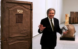 Antoni Tapies: Tapies poses next to one of his artworks