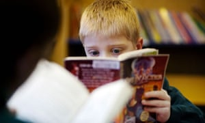 A child reading in the library at a primary school