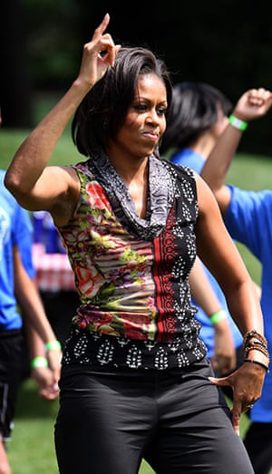 Michelle Obama fitness:  First Lady Michelle Obama exercises with children on the South Lawn