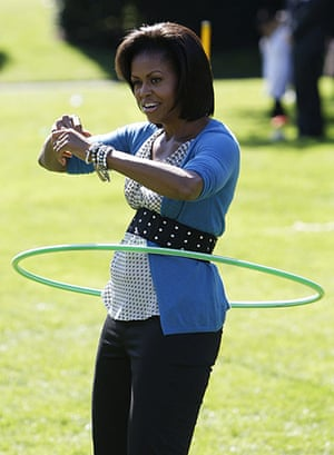 Michelle Obama fitness: Michelle Obama exercises with a hula hoop during a healthy kids fair