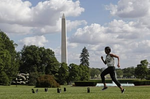 Michelle Obama fitness: First lady Michelle Obama runs across the South Lawn