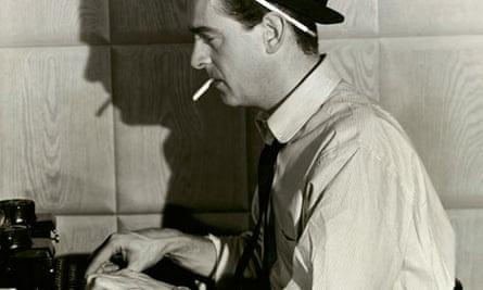 Newspaper reporter at typewriter