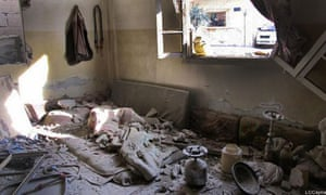 A house damaged by the Syrian government forces bombardment in the Bab al-Amr neighborhood in Homs