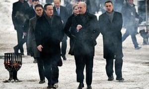 David Cameron talks to Fredrik Reinfeldt in front of Jyrki Katainensom and Jens Stoltenberg