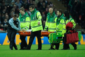 England v Holland: Chris Smalling is carried off on a stretcher after a clash of heads