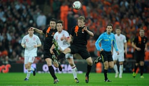 England v Holland: Scott Parker plays a pass despite the challenge from Van Bommel and Kuyt