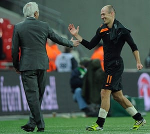 England v Holland: Arjen Robben with his manager Bert Van Marwijk after the final whistle