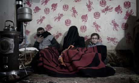 A Syrian family shelter in Baba Amr during shelling by regime forces in early Feburary