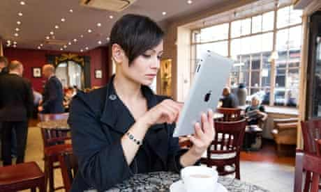 Young woman browsing the Internet on an Apple iPad 2 tablet