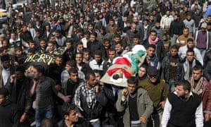 Palestinian mourners carry the bodies of people killed in Israeli air strikes on the Gaza Strip