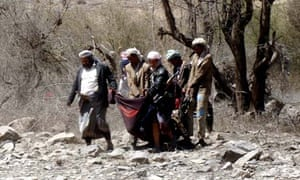 Militants carry the body of one of their number killed in an air strike