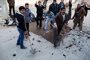 Syria Annan: People remove a speed bump to allow ambulances to drive faster in Idlib