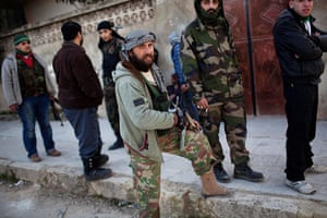 Syria Annan: Free Syrian Army fighters gather during fighting against government troops