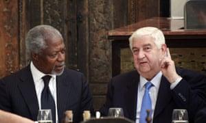UN and Arab League envoy Kofi Annan with Syrian foreign minister Walid al-Moallem