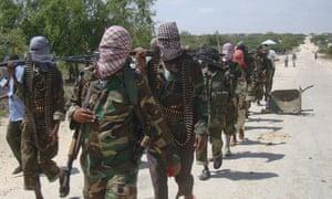 Al-Shabab fighters walk through Mogadishu