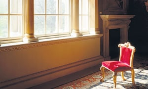 Velvet chair in front of a big window in a grand house