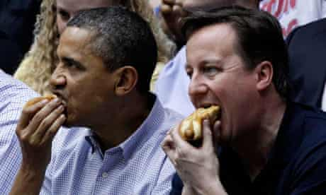 Barack Obama and David Cameron each eat hot dogs at NCAA basketball tournamnet game in Ohio