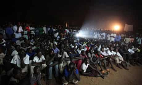 "Residents watch the premiere of ""Kony 2012"" in Lira district"