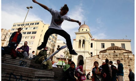 A Greek youth performs skateboard tricks in Athens