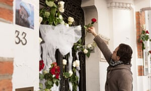 Mourners after fire bomb attack on Reda Mosque, Brussels