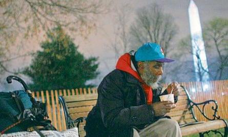 Homeless man on a bench in Washington DC