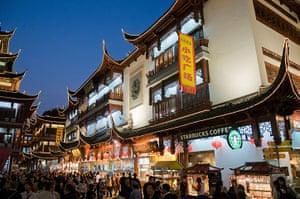 Unusual chain restaurants: Shoppers crowd Yuyuan Gardens and Bazaar at dusk, Shanghai, China