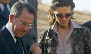 Fawaz Akhras holds the hand of his daughter, Syria's first lady Asma al-Assad during a tour of Ebla