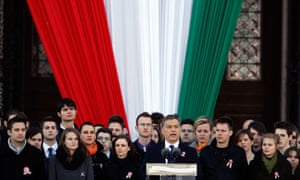 Viktor Orbán delivers a speech in front of the Hungarian parliament building in Budapest