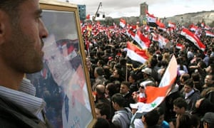 Pro-government supporters rally in Syria as Bashar al-Assad claims leaked emails are hoax