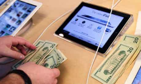 Apple employee counts money new iPad