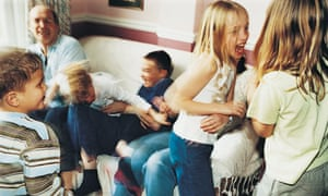 foster family playing around a sofa