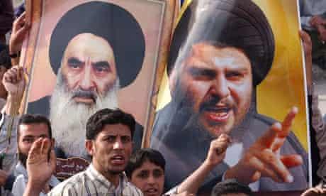 Posters depicting Shiite clerics Grand Ayatollah Ali Sistani (L) and Moqtada al Sadr