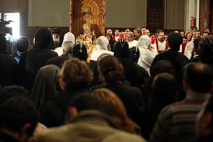 Pope Shenouda III: Egyptian Christians gather inside the Abassiya Cathedral