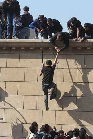 Pope Shenouda: An Egyptian Christian trying to climb the walls of the cathedral, Abbasseya
