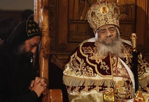 Pope Shenouda: A mourner prays next to the body of Pope Shenouda